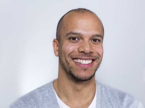 Portrait of a man in a tee shirt smiling to camera